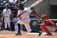 Northwest Arkansas Naturals Orlando Calixte (7) swings during the game against the Springfield Cardinals at Arvest Ballpark on May 4, 2016 in Springdale, Arkansas.  Springfield won 10-6.  (Dennis Hubbard/Four Seam Images)