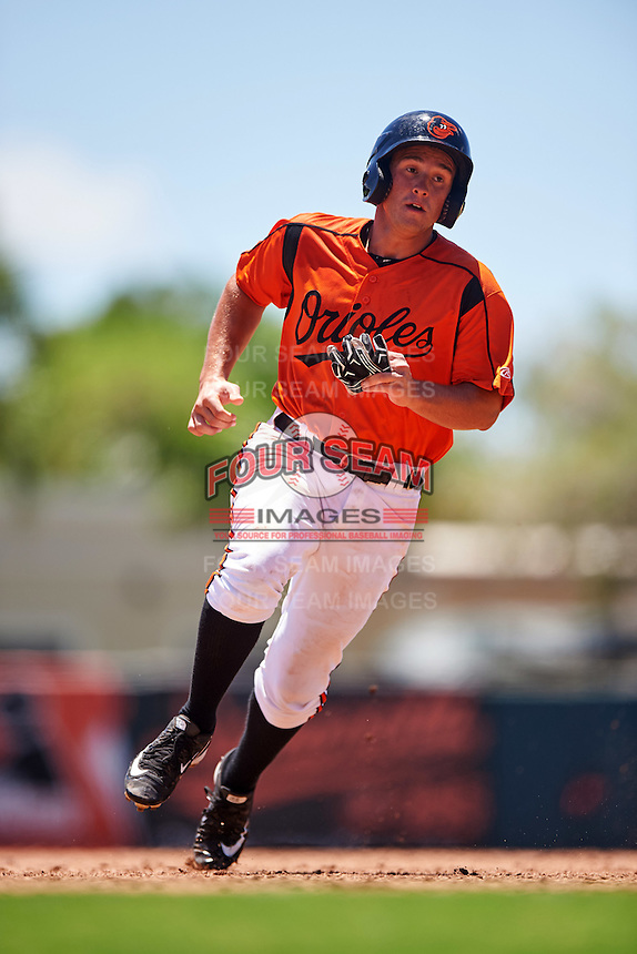 GCL Orioles second baseman Garrett Copeland (15) running the bases during a game against the GCL Twins on August 11, 2016 at the Ed Smith Stadium in Sarasota, Florida.  GCL Twins defeated GCL Orioles 4-3.  (Mike Janes/Four Seam Images)