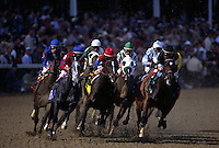 Horses on the first turn of a race at Churchill Downs race track.