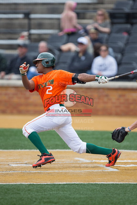 Ricky Eusebio (2) of the Miami Hurricanes follows through on his swing against the Wake Forest Demon Deacons at Wake Forest Baseball Park on March 22, 2015 in Winston-Salem, North Carolina.  The Demon Deacons defeated the Hurricanes 10-4.  (Brian Westerholt/Four Seam Images)