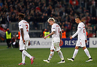 Calcio, andata dei sedicesimi di finale di Europa League: Roma vs Feyenoord. Roma, stadio Olimpico, 19 febbraio 2015.<br /> From left, Roma's Mapou Yanga-Mbiwa, Radja Nainggolan and Jose' Holebas leave the pitch at the end of the Europa League round of 32 first leg football match between AS Roma and Feyenoord at Rome's Olympic stadium, 25 February 2015. The game ended 1-1.<br /> UPDATE IMAGES PRESS/Riccardo De Luca