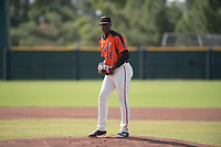 San Francisco Giants relief pitcher Gregory Santos (76) prepares to deliver a pitch during an Instructional League game against the Kansas City Royals at the Giants Training Complex on October 17, 2017 in Scottsdale, Arizona. (Zachary Lucy/Four Seam Images)