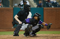 Winston-Salem Dash catcher Xavier Fernandez (12) sets a target as home plate umpire Mitch Leikam looks on during the game against the Greensboro Grasshoppers at First National Bank Field on June 3, 2021 in Greensboro, North Carolina. (Brian Westerholt/Four Seam Images)