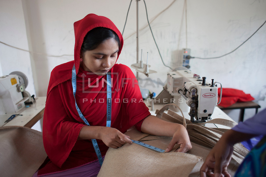 Mili Khatun, 24, survived the collapse of Rana Plaza on April 24, 2013 but her husband didn't. Mili and another four survivors now work in a model garment factory called 'Oporajeo', a worker-owned factory in Savar, near Dhaka, Bangladesh