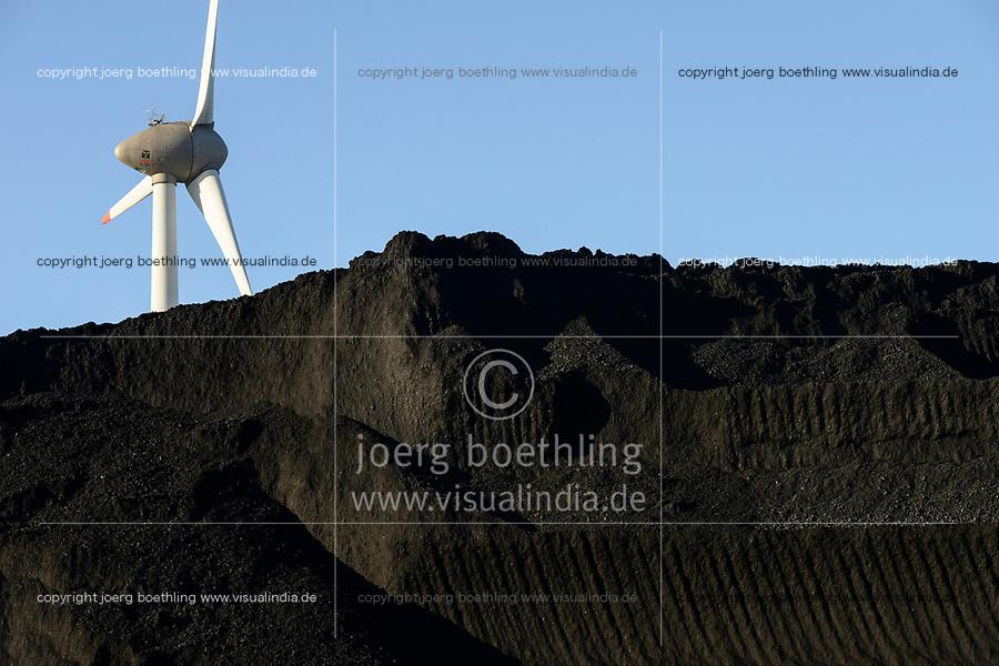 Germany, Hamburg, Hansaport import of coal and ore for steel plants and coal power stations, coal storage place in contrast with wind turbine  / DEUTSCHLAND, Hamburg, Hansaport, Import von Kohle und Erz, Lagerung und Weitertransport zu Kraftwerken und Stahlwerken