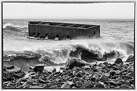 Wave Curls<br /> The ruins of Uncle Harvey's Mausoleum get battered by powerful waves during winter storms. Water cascades out the window openings after each wave passes.