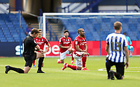 Players and match officials 'take the knee' in a gesture of support for the Black Lives Matter campaign<br /> <br /> Photographer Rich Linley/CameraSport<br /> <br /> The EFL Sky Bet Championship - Sheffield Wednesday v Nottingham Forest - Saturday 20th June 2020 - Hillsborough - Sheffield <br /> <br /> World Copyright © 2020 CameraSport. All rights reserved. 43 Linden Ave. Countesthorpe. Leicester. England. LE8 5PG - Tel: +44 (0) 116 277 4147 - admin@camerasport.com - www.camerasport.com