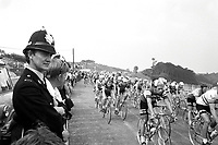 29/6/1974 Tour de France 1974.<br /> Stage 2 - Plymouth.<br /> Police line the route of the TDF as the peloton races by.<br /> Photo: Offside / L'Equipe. COPYRIGHT WARNING : THIS IMAGE IS RIGHTS MANAGED AND THE COPYRIGHT MAY SIT WITH A THIRD PARTY PLEASE CONTACT simon@swpix.com BEFORE DOWNLOAD AND OR USE