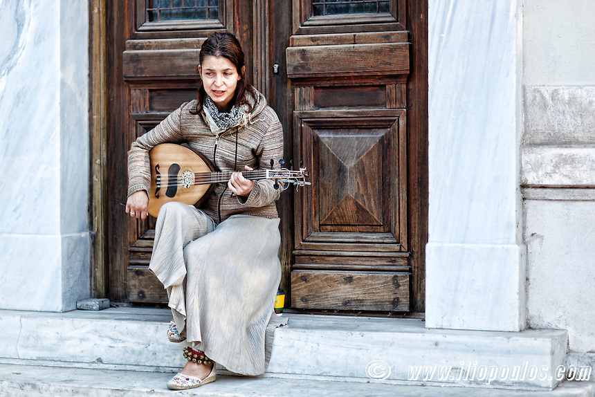 A musician playing in the street of Athens, Greece