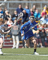 Duke University midfielder Molly Quirke (22) on the attack. Boston College (white) defeated Duke University (blue), 10-9, on the Newton Campus Lacrosse Field at Boston College, on April 6, 2013.