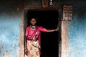 A maria tribes woman poses for a portrait outside her house in village Godhari in Chattisgarh, India. Photo: Sanjit Das