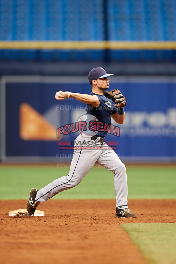 Connor Hollis (4) throws to first base during the Tampa Bay Rays Instructional League Intrasquad World Series game on October 3, 2018 at the Tropicana Field in St. Petersburg, Florida.  (Mike Janes/Four Seam Images)