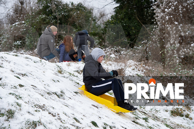 Families enjoy the sledging following snowfall at Foots Cray Meadow, Sidcup, Kent, England on the 9 February 2021. Photo by Alan Stanford.