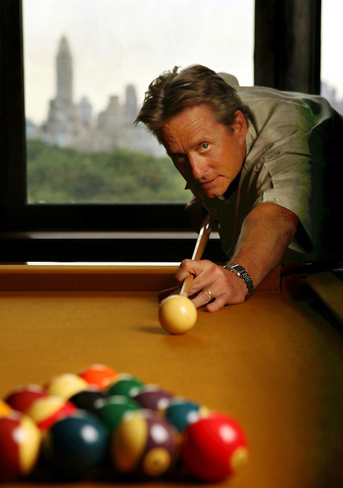 MICHAEL DOUGLAS at home with golden surface billiard table.  He stars in new indie film, KING OF CALIFORNIA. Views of Central Park and Upper East Side behind him out window.  151 Central Park West, NYC.  Newsday/ARI MINTZ  8/17/2008.