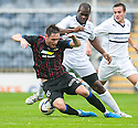 Caley's Greg Tansey is brought down by Raith Rovers' Christian Nade.