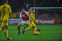 Fleetwood Town's forward Ched Evans (9) challenges Burton Albion's midfielder Jamie Allen (4) during the Sky Bet League 1 match between Fleetwood Town and Burton Albion at Highbury Stadium, Fleetwood, England on 15 December 2018. Photo by Stephen Buckley / PRiME Media Images.