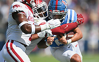 Ole Miss quarterback Matt Corral (2) carries the ball as Arkansas defensive back Joe Foucha (7) blocks, Saturday, October 9, 2021 during the second quarter of a football game at Vaught Hemingway Stadium in Oxford, Miss. Check out nwaonline.com/211010Daily/ for today's photo gallery. <br /> (NWA Democrat-Gazette/Charlie Kaijo)