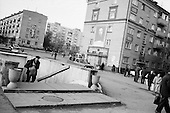 """Moscow, Russia<br /> October 21, 1992<br /> <br /> A Lenin poster hangs over a small market in the Moscow suburbs.<br /> <br /> In December 1991, food shortages in central Russia had prompted food rationing in the Moscow area for the first time since World War II. Amid steady collapse, Soviet President Gorbachev and his government continued to oppose rapid market reforms like Yavlinsky's """"500 Days"""" program. To break Gorbachev's opposition, Yeltsin decided to disband the USSR in accordance with the Treaty of the Union of 1922 and thereby remove Gorbachev and the Soviet government from power. The step was also enthusiastically supported by the governments of Ukraine and Belarus, which were parties of the Treaty of 1922 along with Russia.<br /> <br /> On December 21, 1991, representatives of all member republics except Georgia signed the Alma-Ata Protocol, in which they confirmed the dissolution of the Union. That same day, all former-Soviet republics agreed to join the CIS, with the exception of the three Baltic States."""