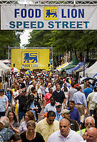 Crowds walk around during Food Lion Speed Street in uptown Charlotte, NC.