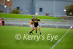 Dr Crokes Shane Lyne and Keith O'Connor of   Abbeydorney keep their eye on the sliotar in the County Senior hurling championship game on Sunday