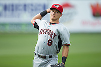 Jose Cardona (8) of the Hickory Crawdads warms up in the outfield prior to the game against the Kannapolis Intimidators at CMC-Northeast Stadium on April 17, 2015 in Kannapolis, North Carolina.  The Crawdads defeated the Intimidators 9-5 in game one of a double-header.  (Brian Westerholt/Four Seam Images)