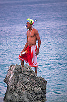 Man with fish he just caught at Coki Beach. St. Thomas. US Virgin Islands.
