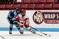 BOSTON, MA - JANUARY 04: Amalie Andersen #11 of University of Maine closely defends                        Emma Wuthrich #19 of Boston University during a game between University of Maine and Boston University at Walter Brown Arena on January 04, 2020 in Boston, Massachusetts.