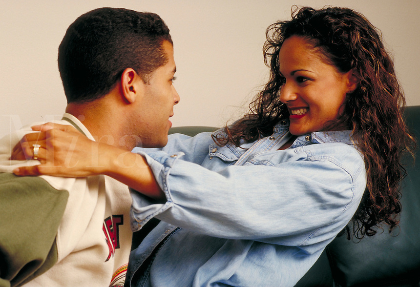 Series of various expressions and moods of a young ethnic couple in love. Young ethnic couple. Houston Texas USA.