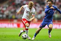 8th September 2021; PGE National Stadium, Warsaw, Poland: FIFA World Cup 2022 Football qualification, Poland versus England;  KAMIL JOZWIAK takes on JACK GREALISH