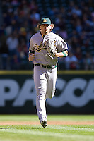 September 28, 2008: Oakland Athletics' Travis Buck trots in from right field during a game against the Seattle Mariners at Safeco Field in Seattle, Washington.