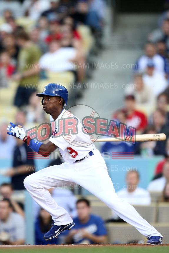 Los Angeles Dodgers shortstop Dee Gordon #9 bats against the Cincinnati Reds at Dodger Stadium on June 14, 2011 in Los Angeles,California. (Larry Goren/Four Seam Images)