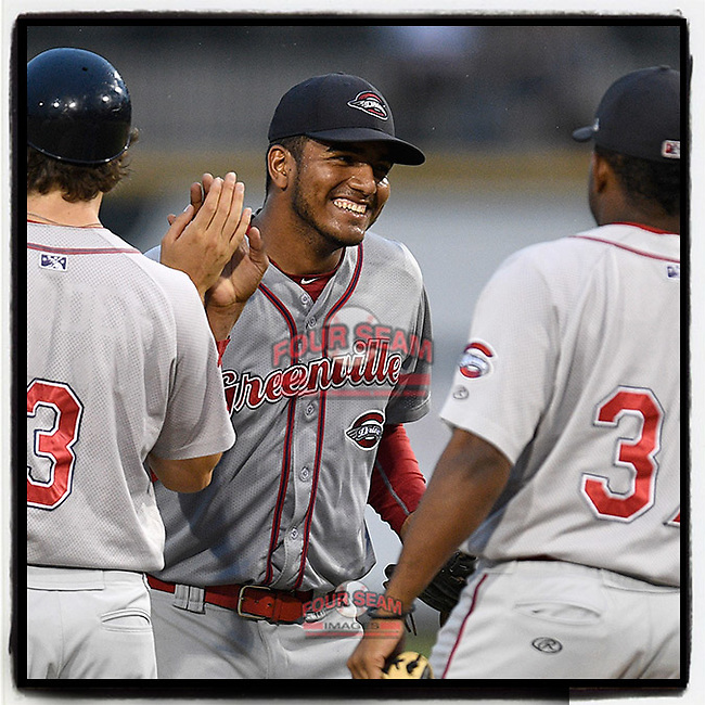 Pitcher Denyi Reyes (41) of the Greenville Drive is congratulated after using just 92 pitches to post a nine-inning complete-game shutout against the Columbia Fireflies on Sunday, May 27, 2018, at Spirit Communications Park in Columbia, South Carolina. Greenville won, 3-0. It was the first complete-game shutout in the South Atlantic League this season. (Tom Priddy/Four Seam Images)