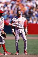 SAN FRANCISCO, CA - Barry Larkin and Deion Sanders of the Cincinnati Reds talk on the field against the San Francisco Giants during a game at Candlestick Park in San Francisco, California in 1997. Photo by Brad Mangin