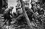 U.S. Marines carry a wounded soldier, Têt offensive, Battle of Hué, Vietnam, February 1968