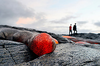 Sunrise, Hikers, Small pahoehoe lava flow, Kilauea volcano, Hawaii, USA Volcanoes National Park, Big Island of Hawaii, USA