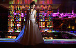 A Las Vegas model stands on the bar in the nightclub Tabu at MGM Grand Hotel in Las Vegas, Nevada, in a wedding dress for a bridal fashion shoot on January 30, 2004.