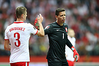 8th September 2021; PGE National Stadium, Warsaw, Poland: FIFA World Cup 2022 Football qualification, Poland versus England;  PAWEL DAWIDOWICZ high fives WOJCIECH SZCZESNY