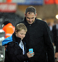 Swansea manager Paul Clement pauses for a selfie as he arrives prior to the game during the Carabao Cup Fourth Round match between Swansea City and Manchester United at The Liberty Stadium, Swansea, Wales, UK. Tuesday 24 October 2017