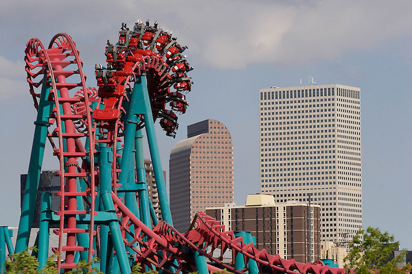 The Loop at Elitch Gardens Amusement Park with downtown Denver, Denver, Colorado.