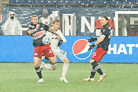 FOXBOROUGH, MA - NOVEMBER 1: Alexander Buttner #28 of New England Revolution gets ready to cross the ball under pressure from Griffin Yow #22 of DC United during a game between D.C. United and New England Revolution at Gillette Stadium on November 1, 2020 in Foxborough, Massachusetts.