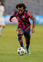 KANSAS CITY, KS - JULY 15: Gianluca Busio #6 of the United States moves towards the box during a game between Martinique and USMNT at Children's Mercy Park on July 15, 2021 in Kansas City, Kansas.