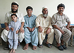 """Brother (from left to right) Sirajullah (36) with son Hishirs(6) , Imranullah (26) , Abdul Jabar and Israrullah Shah(42) at Nawagai village in the troubled Buner District of Pakistan's North West Frontier Province. Abdul and Sirajullah have just returned to their home after spending 60 days at the Chota Lahore refugee camp in dire conditions. Israrullah stayed behind during the fighting between the army and Taliban to ensure the safety of their homes and possessions surviving bullets and air strikes. By a quirk of fate Imranullah was working for an NGO at the refugee camp at the same time. Coming back to their homes was like """"Eid"""" according to the brothers who number six in total.  The Pakistani army claims to have driven the Taliban from the area and many people are leaving the refugee camps in Swabi and heading home. Reports of continuing Taliban presence in the area continue to surface however and it is clear the area is still far from safe and secure."""