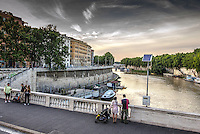 Travel Print Photograph. A romantic river scene of the Tiber river in the ancient city of Rome. The lighting of the day reveals the subtle textures of the river water, and the historical building that gracefully line the fortified walls of the river shoreline.