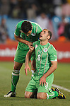 PRETORIA - JUNE 23:  Algeria team captain Anther Yahia (l) helps teammate Medhi Lacen (r) to his feet after Algeria conceded an injury time goal to the United States to crash out of the 2010 FIFA World Cup June 23, 2010 in Pretoria, South Africa.  Editorial use only.  Commercial use prohibited.  No push to mobile device usage.  (Photograph by Jonathan Paul Larsen)