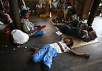 Cyclone Nargis survivor sleep at a temple turned into a makeshift refugee center at the village of Kamingo at the Irrawaddy Division, May 10, 2008. Despairing survivors in Myanmar awaited emergency relief on Friday, a week after 100,000 people were feared killed as the cyclone roared across the farms and villages of the low-lying Irrawaddy delta region. The storm is the most devastating one to hit Asia since 1991, when 143,000 people were killed in neighboring Bangladesh. Photo by Eyal Warshavsky  *** Local Caption *** ëì äæëåéåú ùîåøåú ìàéì åøùáñ÷é àéï ìòùåú áúîåðåú ùéîåù ììà àéùåø
