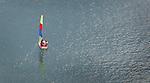 A sail boat float in a small bay in Magic Island, Oahu, Hawaii.
