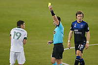 SAN JOSE, CA - SEPTEMBER 19: Referee Rosendo Mendoza issues a yellow card to Tomas Conechny #19 of the Portland Timbers during a game between Portland Timbers and San Jose Earthquakes at Earthquakes Stadium on September 19, 2020 in San Jose, California.