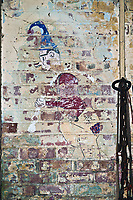 ©Si Barber 07739 472 922. <br /> A mural depicting  a cartoon figure in derelict buildings at former US Air Force base RAF Flixton, Suffolk.<br /> <br /> USAGE TERMS: ONE USE IN PRINT AND ONLINE. NO SYNDICATION, RETENTION, OR THIRD PARTY SALES. MINIMUM FEES APPLY