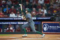 Jared McKenzie (18) of the Baylor Bears follows through on his swing against the Arkansas Razorbacks in game nine of the 2020 Shriners Hospitals for Children College Classic at Minute Maid Park on March 1, 2020 in Houston, Texas. The Bears defeated the Razorbacks 3-2. (Brian Westerholt/Four Seam Images)