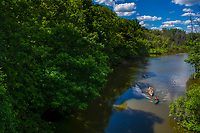 Kayakers and canoeists approach the bridge over Big Walnut Creek